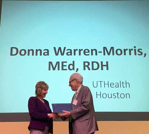 Retired UT System executive Kenneth Shine, MD, welcomes Donna Warren Morris, RDH, MEd, to membership in the academy of health science education named in his honor.