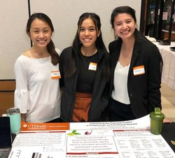 From left are Lac-Hong Pham, Lisa Nguyen, and Thuy Bui, who tied for second place in the GHDHS scientific poster competition.