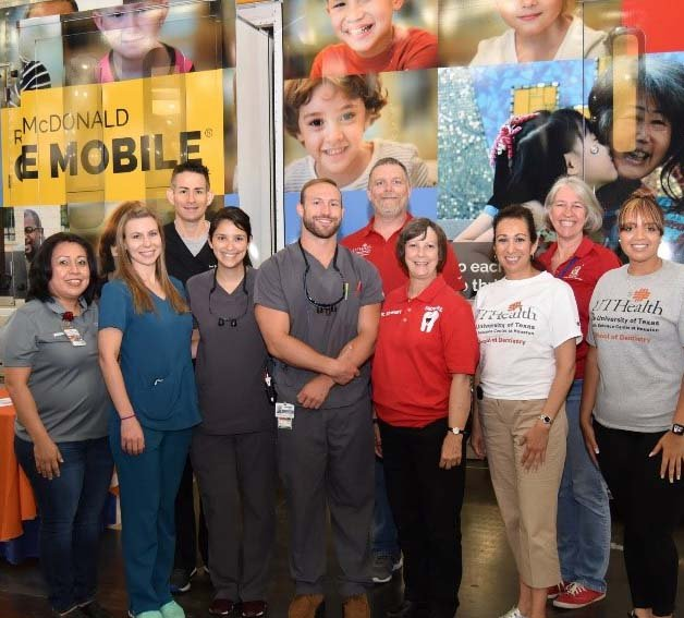 UTHealth Houston dental team in front of the Ronald McDonald Care Mobile.