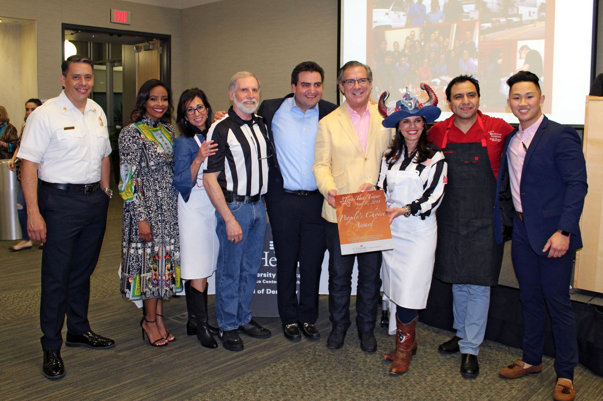 The judges and hosts of the Texas Taste Teaser present the People's Choice Award to Mandola's Catering.