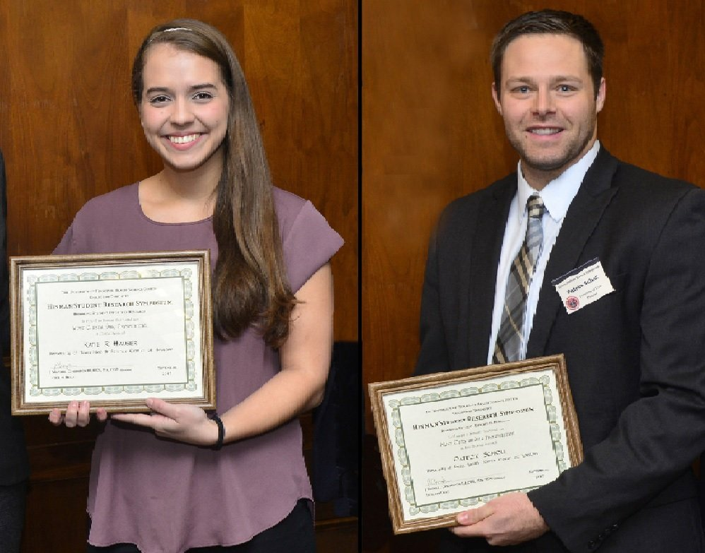Dental students Katie Hauser and Patrick Scholl hold their awards