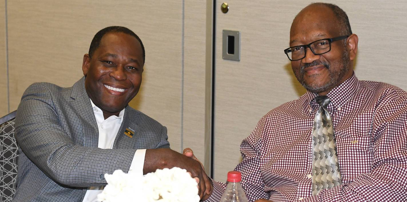 Dr. Harry Joseph (left) shakes hands with his mentor in the fellowship program, Dr. C.D. Johnson.
