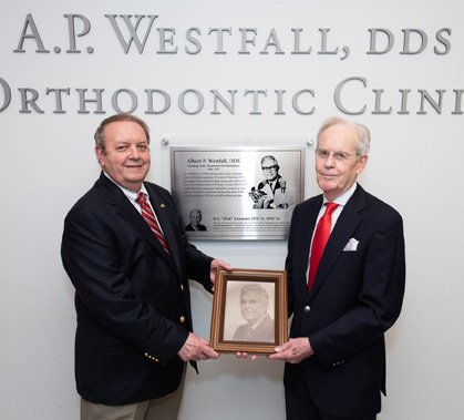 "Dr. Jeryl English (left) and Dr. R.G. ""Wick"" Alexander hold a photograph of Dr. A.P. Westfall, who founded UTHealth School of Dentistry's Department of Orthodontics in 1956."
