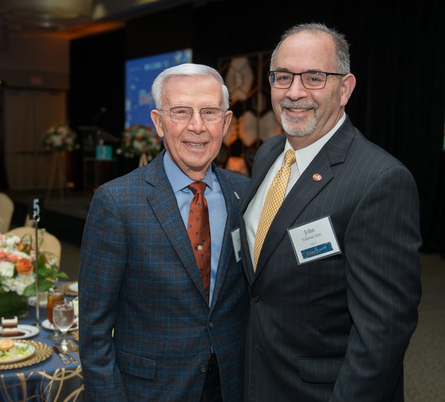 Dr. Fred Garrett (left) standing with Dean John Valenza at the STAR Awards Luncheon.