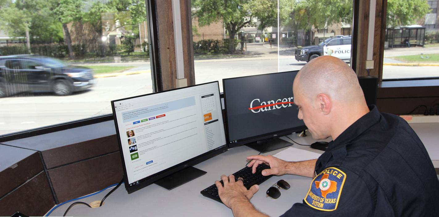 A UTPD officer uses a computer in the renovated guardhouse on Cambridge Street