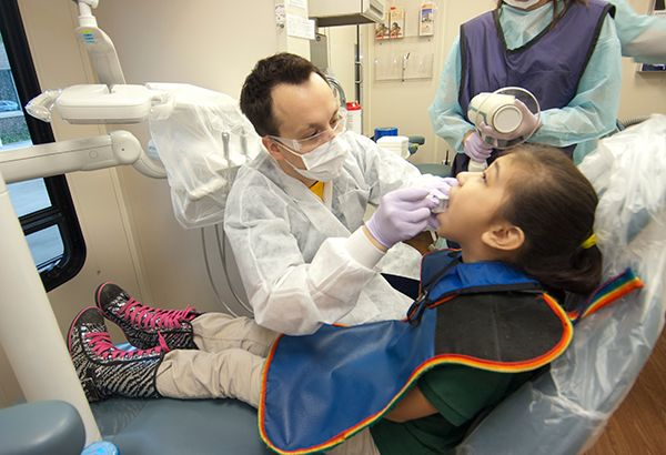 Resident working on a pediatric patient