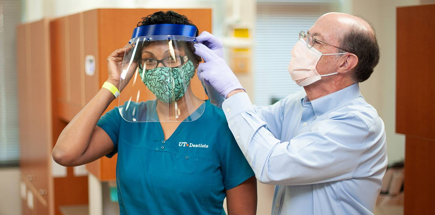 Dr. Scott Makins a 3D-printed face shields for a UT Dentist employee
