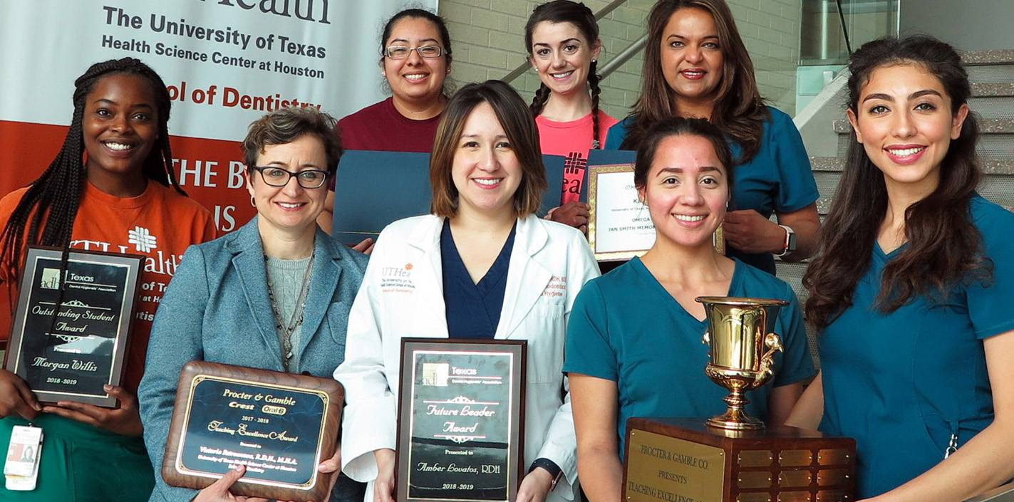UTSD dental hygiene students and faculty holding awards