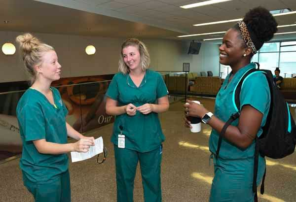 three dental hygiene students talking during a break