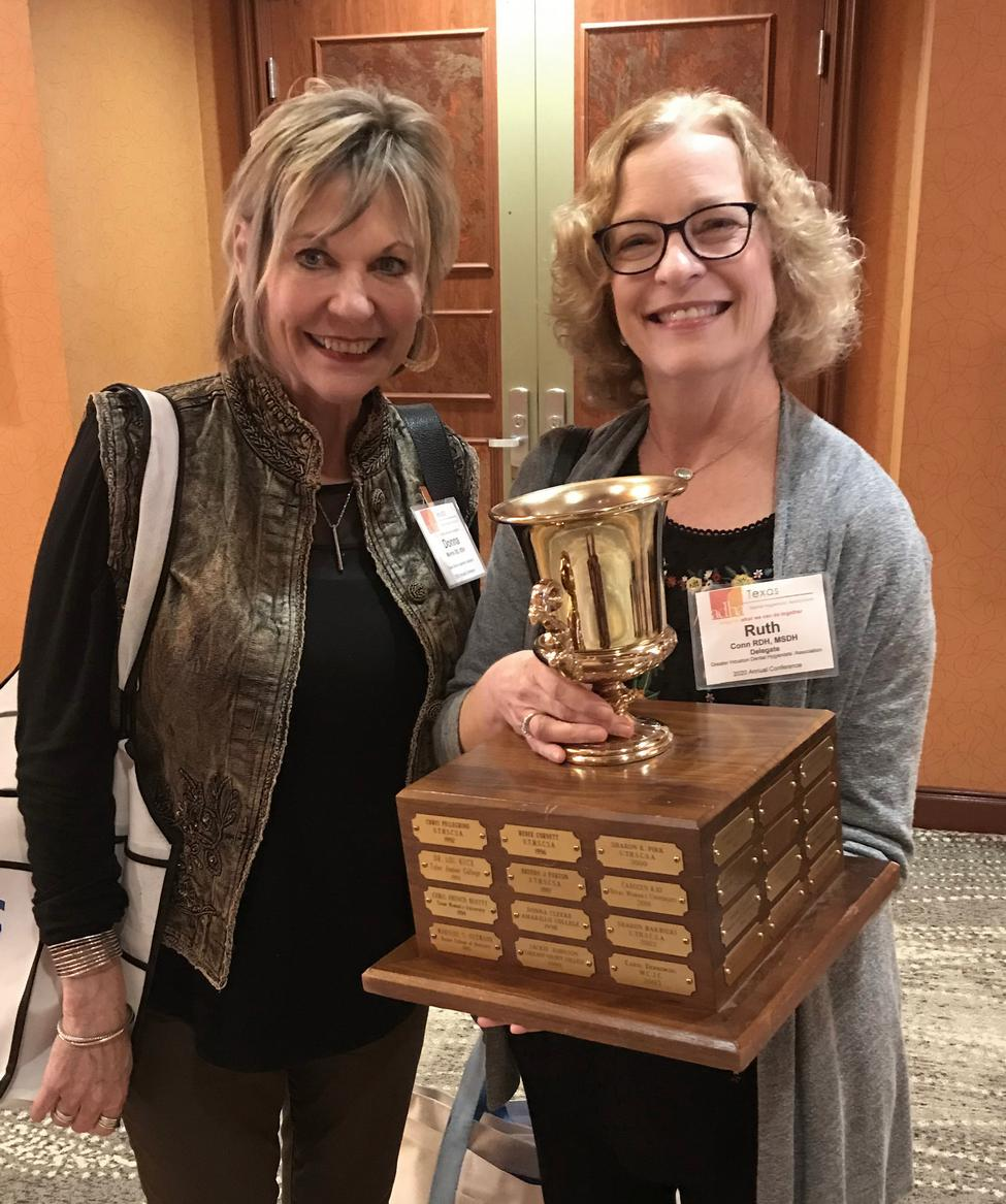 Clinical Assistant Professor Ruth Conn, RDH, MSDH, (right) holds the trophy as winner of the Procter and Gamble/TDHA Teaching Excellence Award. At left is Dental Hygiene Program Director Donna Warren Morris, RDH, MEd.