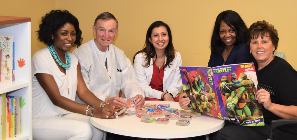 HMC Pediatric Dentistry Clinic welcomes books from Ronald