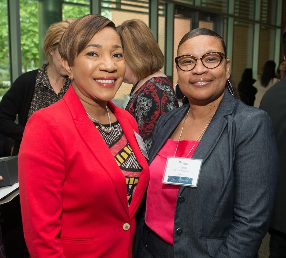 At the STAR Awards luncheon, honorees Mamie Ellis (left) and Paula Semien pose for the photographer