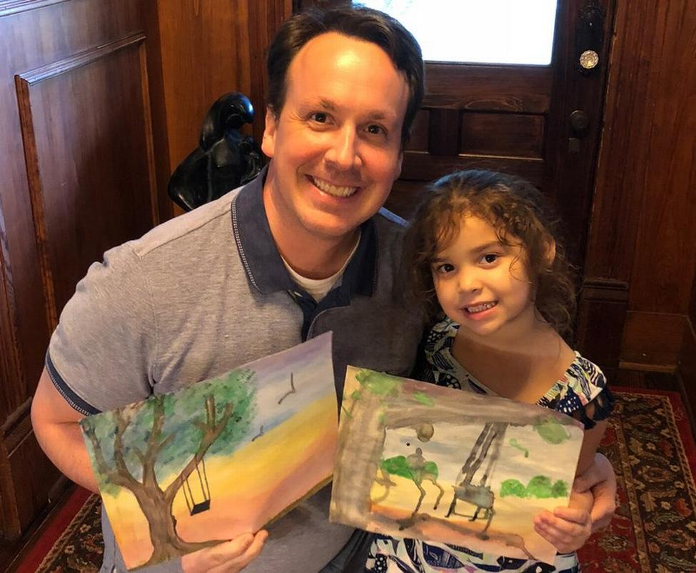 Dr. Brett Chiquet and his 6-year-old daughter Henley display the paintings they did during the ASDA event.