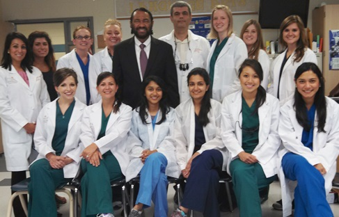 Congressman Al Green (center left) welcomed volunteers from UT School of Dentistry at his third annual Back to School Health Fair at   Westbury High School in Houston.