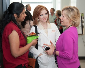 Dr. Jackie Hecht (right) chats with visitors at the Open House for the Center for Craniofacial Research.