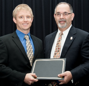 Walter G. Sterling Award winner Jay Littlefield (left) with Dean John A. Valenza, DDS.
