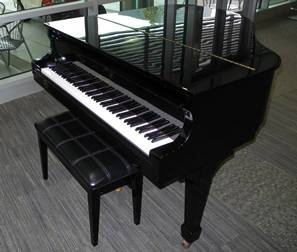 The Schafer & Sons baby grand piano, donated to UTHealth by Dr. Robin Weltman.