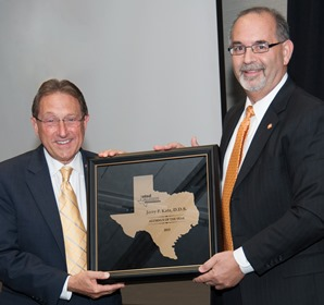 Jerry P. Katz, DDS '68 (left) of Austin receives the UTSD Alumni Association's Outstanding Alumnus Award from the 2012 winner, Dean John A. Valenza, DDS '81.