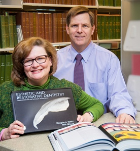 "UTSD Assistant Librarian Janet Peri and Dr. Ray Koeppen, chair of the Department of Restorative Dentistry and Prosthodontics, welcome two signed copies of ""Aesthetic and Restorative Dentistry."""