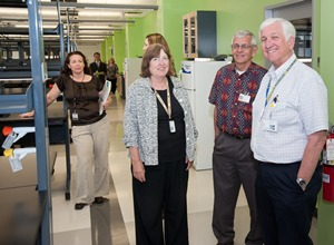 From left, Dr. Gena Tribble, Dr. Kathleen Gibson, Dr. John McMahon and Dr. Ted Pate visit the new facilities of the UTSD Center for Craniofacial Research.
