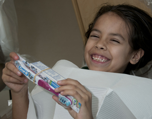 Joslynn Ramirez is all smiles after being treated at UTSD's Give Kids a Smile Day.