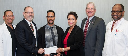 Attending the presentation of the Moritz Craven, DDS Memorial Scholarship are (from left) Dr. David Emmers, Dean John Valenza, DDS; Dr. Judith Craven; the recipient, second-year dental student Terrall Thurman; Associate Dean Philip Pierpont, DDS; and Professor C.D. Johnson, DDS. Photo by Brian Schnupp.