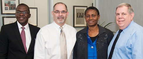 From left: Dr. M. Collins Okwen, Dean John Valenza, DDS; Dr. Alice Umweni, dean of the University of Benin School of Dentistry; and Dr. Sam Dorn, chair of the Department of Endodontics at UTSD.