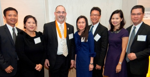 Pictured with UT School of Dentistry Dean John Valenza, DDS, are three couples who, together, created the Doan-Huynh-Le Professorship in General Dentistry. They are Clinical Assistant Professor Don Le, DDS and wife, Cindy Le, PhD; Kim Loan T. Nguyen, DDS '96, and husband T. Alex Huynh, DDS '91; and Kim-Loan T. Nguyen, DDS '96 with husband Anthony S. Doan, DDS '97. Photo by Dwight C. Andrews.