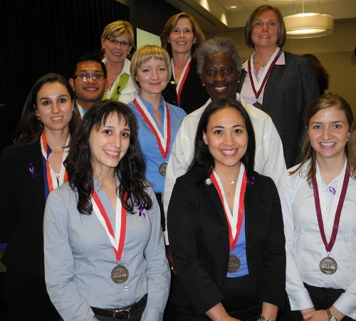 "The ""Forget-Me-Nots"" Team won first place in the Houston Geriatric Education Center's 2013 Interprofessional Student Competition April 22. Front row from left are Solange Inzillo, Antonia Caliboso, Leslie Melton, (middle row from left) Erika Wood, MPH; Gregory Brusola, Sarah Grudier, Dr. Gwendolyn Brobbey (back row from left) team mentor Donna Warren-Morris, RDH, MEd; Kathleen Lanini and Julie Rhodes. Deep Pujara is not pictured. (Photo by Rhonda Whitmeyer)."