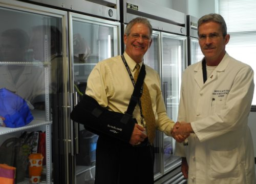 Associate Dean for Student and Alumni Affairs Phil Pierpont, DDS, (left) with UTSD Family & Friends Association President Bruce Smith, DDS, in front of a new refrigerator donated by the association.