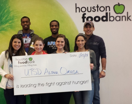 UTSD's Alpha Omega chapter spent a recent Saturday volunteering at the Houston Food Bank.  Pictured (front, from left) are dental students Zelina Moncivais, Erika Mendez, Adrien Lewis and Diana Reyes; (back row from left) Nick Ayoade, Shola Anifowose and Diana's husband, Florentino Reyes.