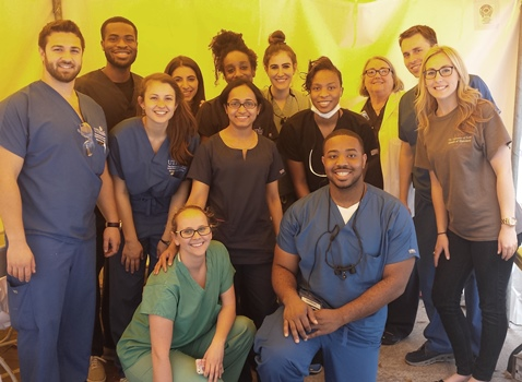 Sugar Land's WATCH Health Fair benefited from dental volunteers. Kneeling from left:  Ashley Marcks, Brian Anyanwu; (standing from left) Francisco Nieves, Shola Anifowose, Mary Glasheen, Sarah Fink, Ida Varghese (front), Meghan Bender, Alana Reifer, Cleona Oliver, Dr. June Sadowsky, Justin Tullis and April Mason. Not pictured is Nick Ayoade.