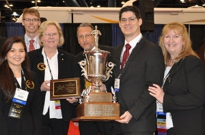 Dr. Alejandro Sosa (center right) won the Edward J. Cooksey Award at the 2012 Star of the South Dental Meeting. From left are Dr. Mai Tram Nguyen, Dr. Karen Waters, Dr. Stephen Laman, and Dr. Kathy Gibson.  Photo courtesy of Greater Houston Dental Society.