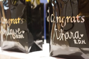Graduates received personalized gifts at UTSD's Dental Hygiene Awards Banquet May 17 at Trevisio.