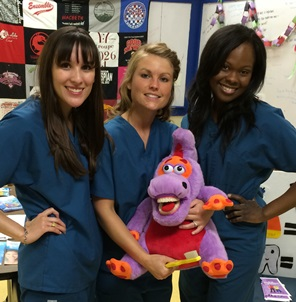 From left:  Dental hygiene students Skyler Jones, Heather Ellis and Denise Murray used teaching tools to show proper brushing.