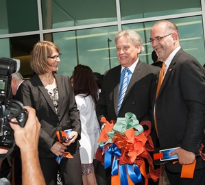 Tony Lentola (center) was among those who cut the ribbon for the School of Dentistry's dedication on June 8, 2012. Also pictured: Dean John Valenza, DDS and Mary Le Johnson of WHR Architects. Photo by Brian Schnupp.