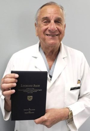 Dr. Robert Debes holds a copy of the Department of Oral and Maxillofacial Surgery's published history, covering 1949-99.  An update for 2000-15 is in the works.