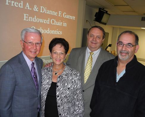 Dr. and Mrs. Fred Garrett (left) have created the first endowed chair in UTSD's history. Pictured with them are Orthodontics Department Chair Jeryl English, DDS, MS (center), and Dean John A. Valenza, DDS.