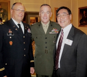 With Dr. Mark Wong (far right) at the U.S. Navy Regenerative Medicine Symposium in Washington, D.C. are Col. Robert Hale (center) and General Joseph Dunford, Jr., assistant commandant of the Marine Corps.