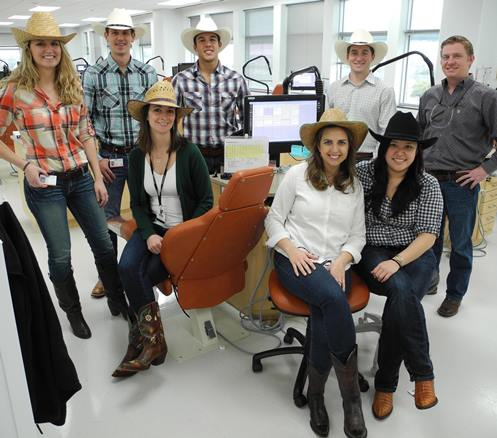 "Orthodontics residents at UT School of Dentistry wearing ""Go Texan"" attire."