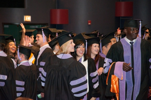 Graduates of the Class of 2013 turn to look at the audience.