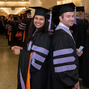 Class of 2014 DDS graduates Khushbu Patel and Victor Parra wait for commencement to begin at Cullen Performance Hall.