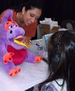 Dental hygiene student Suzette Soca teaches correct brushing.