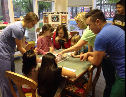 Members of the Pediatric Education Dental Society (P.E.D.S.) at The University of Texas School of Dentistry at Houston play games with children at Ronald McDonald House of Houston.