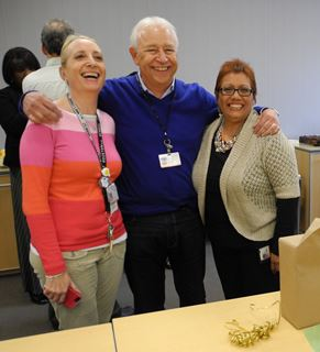 Dr. Rebeca Weisleder and Graphic Services Manager John O'Black pose for a photo with Rebecca Lopez at the retirement party Wednesday. Lopez has worked at UT institutions for 30 years.