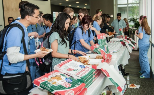 UT School of Dentistry students enjoyed pizza at the 2012 Summer Research Showcase in the Cooley Center.