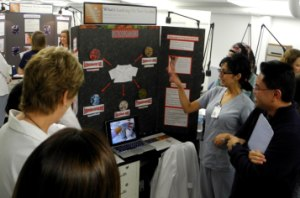 Dental hygiene student Nada Sabir explains results from a study of microbes cultured from scrubs and lab coats.
