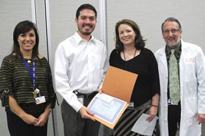 First-year dental student Alex Burger receives the first place award in the DDS student category at the 2014 UTSD Student Table Clinics.  From left are Dr. Ariadne Letra, Burger, Dr. Gena Tribble and Dr. Stephen Laman. Letra and Tribble are Houston AADR officers, and Laman is the table clinic coordinator.