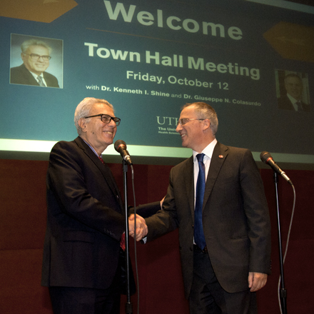 Dr. Kenneth Shine (left) greets the sole finalist for president of UT Health Science Center at Houston, Dr. Giuseppe Colasurdo, at a town hall meeting Oct. 12.