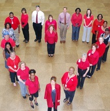 UTHealth employees wearing red clothing form the shape of a heart to raise awareness of Go Red for Women Day.